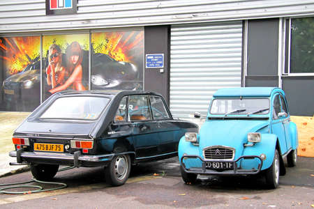 utilitarian: PARIS, FRANCE - AUGUST 7, 2014: French retro cars Renault 16 and Citroen 2CV at the city street. Editorial