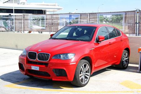 crossover: LA CONDAMINE, MONACO - AUGUST 2, 2014: Red luxury crossover BMW E71 X6M at the city pier.