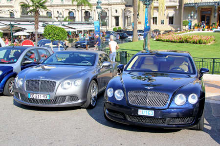 MONTE CARLO, MONACO - AUGUST 2, 2014: British luxury cars Bentley Continental GTC and Bentley Continental Flying Spur at the city street near the casino.