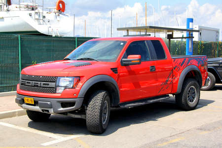 SAINT-TROPEZ, FRANCE - AUGUST 3, 2014: Red american pickup car Ford F150 Raptor at the city street. Editorial