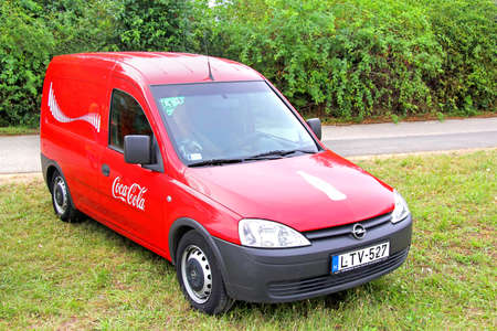 BUDAPEST, HUNGARY - JULY 27, 2014: Coca-Cola designed cargo van Opel Combo at the countryside.
