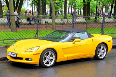 SAINT PETERSBURG, RUSSIA - MAY 26, 2013: Yellow american sportscar Chevrolet Corvette at the city street.