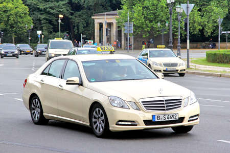 mercedes: BERLIN, GERMANY - AUGUST 15, 2014: Beige taxi car Mercedes-Benz W212 E-class at the city street.