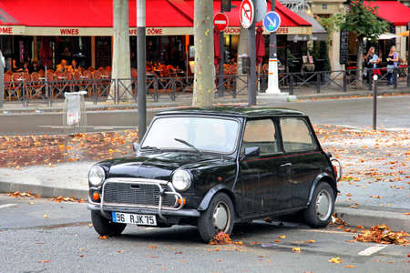 afford: PARIS, FRANCE - AUGUST 8, 2014: Classic british compact car Austin Mini Cooper at the city street. Editorial