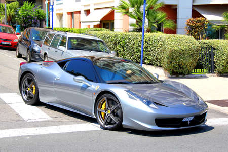 gr: MENTON, FRANCE - AUGUST 2, 2014: Silver italian sports car Ferrari 458 Italia at the street of French Riviera. Editorial