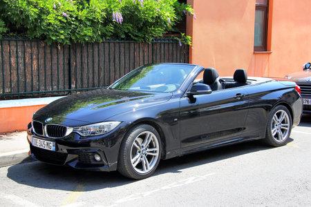 bmw: SAINT-TROPEZ, FRANCE - AUGUST 3, 2014: Black convertible sports car BMW F33 4-series at the city street.