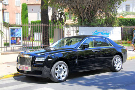 gr: SAINT-TROPEZ, FRANCE - AUGUST 3, 2014: Black british premium class sedan Rolls-Royce Ghost at the city street. Editorial