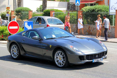gr: SAINT-TROPEZ, FRANCE - AUGUST 3, 2014: Silver sports car Ferrari 599 GTB Fiorano at the city street.