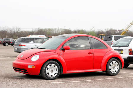 mini car: UFA, RUSSIA - APRIL 19, 2012: Red compact car Volkswagen Beetle in the used cars trade center.