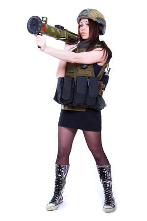 Woman in a military camouflage holding a grenade launcher isolated over white background photo