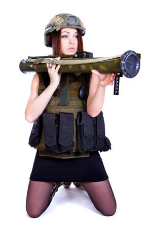 Woman in a military camouflage with a grenade launcher isolated over white background