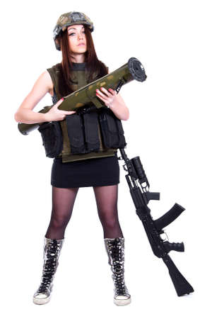 Woman in a military camouflage with a grenade launcher and an assault rifle isolated over white background photo