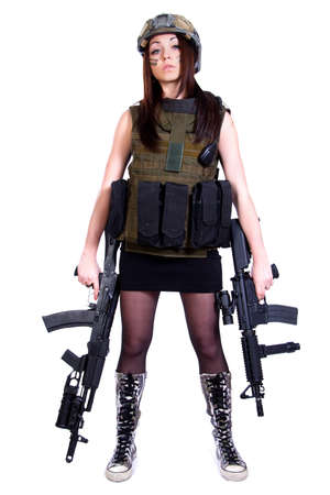Woman in a military camouflage with two assault rifles isolated over white background photo