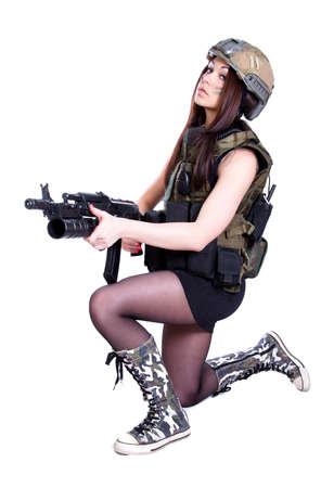 camouflage woman: Woman in a military camouflage sitting with the assault rifle isolated over white