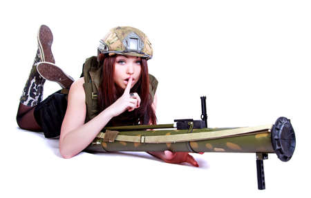 Woman in a military camouflage with a grenade launcher isolated over white background photo