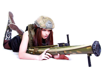 Woman in a military camouflage with a grenade launcher isolated over white  photo