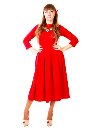 red evening: Young woman in a bright red evening dress isolated over white background