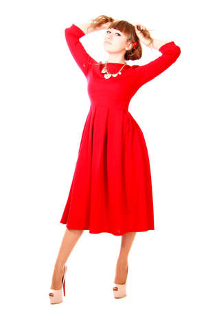 Young woman in a bright red evening dress isolated over white background photo