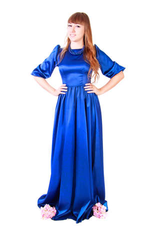 nice stay: Young attractive woman in a long blue evening dress isolated over white background Stock Photo