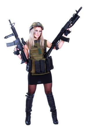 camouflage woman: Woman in a military camouflage with two assault rifles isolated over white background Stock Photo
