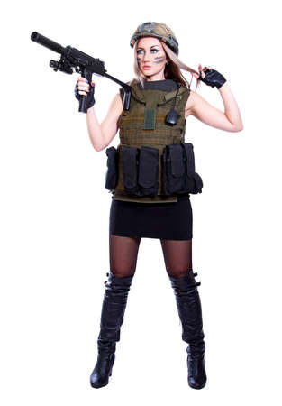 Woman in a military camouflage holding the smg isolated over white background photo