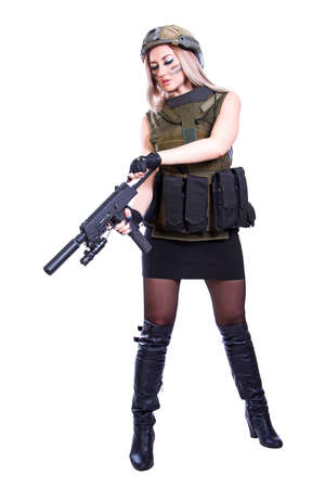 reloading: Woman in a military camouflage reloading the smg isolated over white background Stock Photo
