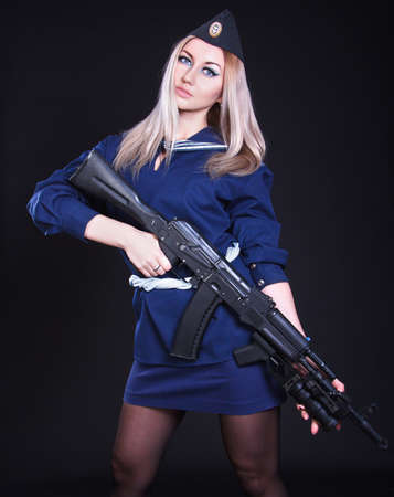 cadet blue: Woman in the marine uniform with an assault rifle over black