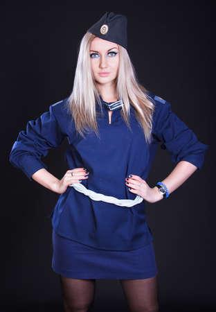 cadet blue: Woman in a blue marine uniform over black