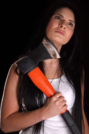 gullet: Young woman with a big axe over black background