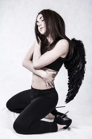 sexy devil: Fallen angel over grey background Stock Photo