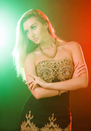 blondy: Beautiful young woman between red and green bright lights