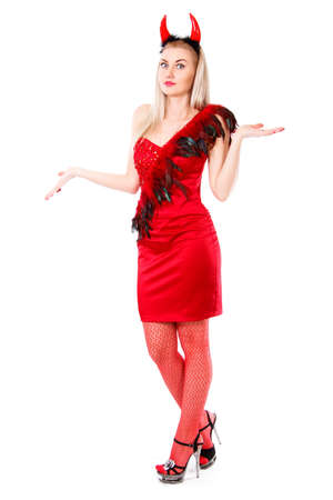 misunderstanding: Misunderstanding young woman in a devil costume isolated over white background
