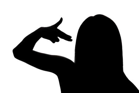 black shadow: Silhouette of a woman pointing fingers to the head like shooting a gun