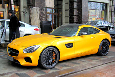 MOSCOW, RUSSIA - MARCH 8, 2015: Brand new yellow supercar Mercedes-AMG GT at the city street. Редакционное