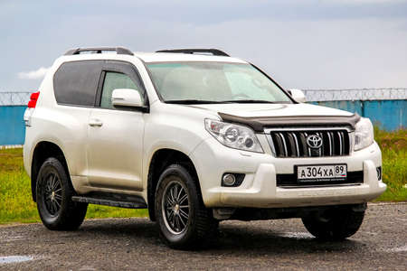 toyota: NOVYY URENGOY, RUSSIA - JULY 16, 2015: Motor car Toyota Land Cruiser Prado 150 at the city street.