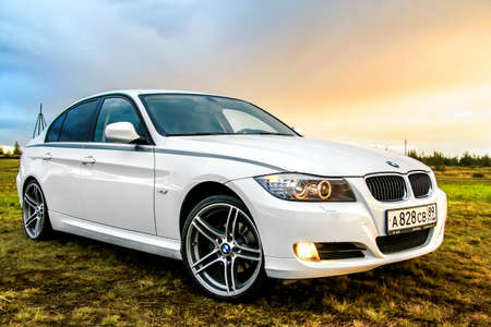 bmw: NOVYY URENGOY, RUSSIA - AUGUST 21, 2015: Motor car BMW E90 318i at the countryside. Editorial