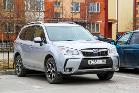forester: NOVYY URENGOY, RUSSIA - JUNE 11, 2014: Motor car Subaru Forester at the city street.