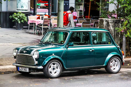 BERLIN, GERMANY - AUGUST 16, 2014: Motor car Mini Cooper at the city street. Editorial