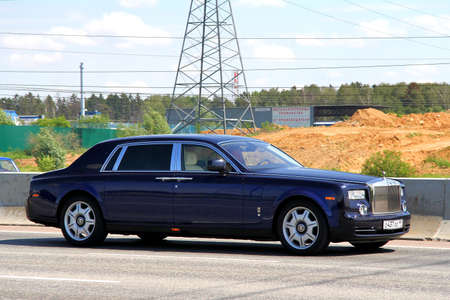 phantom: MOSCOW, RUSSIA - JUNE 2, 2012: Dark blue premium class sedan Rolls-Royce Phantom EWB at the city street. Editorial