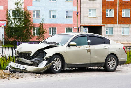 crashed: NOVYY URENGOY, RUSSIA - JULY 5, 2015: Grey motor car Nissan Teana after a heavy crash at the city street. Editorial