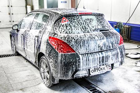 car polish: ASHA, RUSSIA - JANUARY 19, 2012: Motor car Peugeot 308 at the car wash service station.