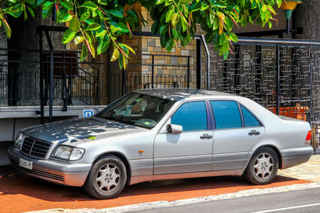 sun s: RIVIERA, FRANCE - AUGUST 2, 2014: Motor car Mercedes-Benz W140 S-class at the city street. Editorial