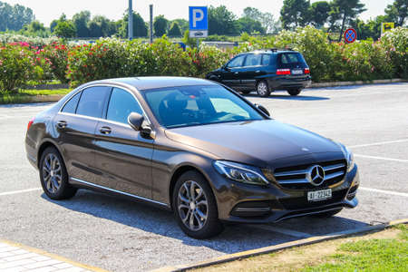 benz: TUSCANY, ITALY - AUGUST 1, 2014: Motor car Mercedes-Benz W205 C-class at the interurban road.