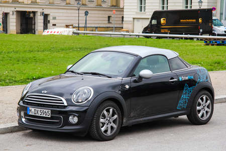 cooper: BERLIN, GERMANY - SEPTEMBER 12, 2013: Motor car Mini Cooper Coupe at the city street.