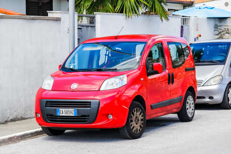 panel van: PISA, ITALY - JULY 31, 2014: Motor car Fiat Qubo at the city street.