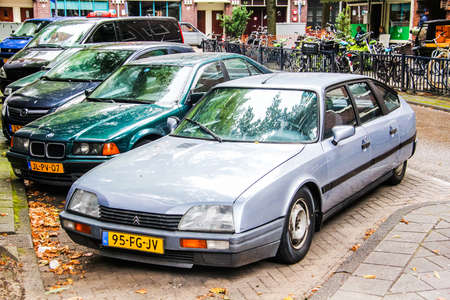 pneuma: AMSTERDAM, NETHERLANDS - AUGUST 10, 2014: French retro car Citroen CX at the city street.