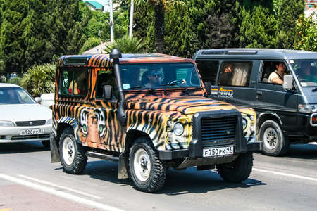 defender: SOCHI, RUSSIA - JULY 26, 2009: Motor car Land Rover Defender at the city street.