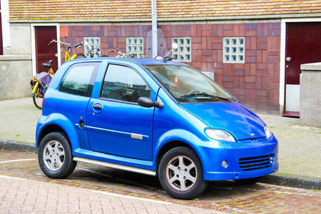 micro drive: AMSTERDAM, NETHERLANDS - AUGUST 10, 2014: Tiny blue car Mountain at the city street. Editorial