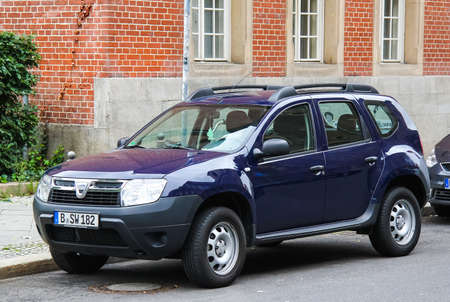 cheapest: BERLIN, GERMANY - SEPTEMBER 12, 2013: Motor car Dacia Duster at the city street.