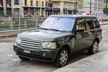 capacious: GENEVA, SWITZERLAND - AUGUST 4, 2014: Grey luxury car Range Rover at the city street.